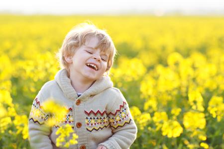 Cute little kid boy in raps field, outdoors. Celebrating Easter holiday.