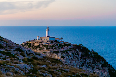 Beautiful white Lighthouse at Cape Formentor in the Coast of North Mallorca, Spain ( Balearic Islands ). Artistic sunrise and dusk landascape