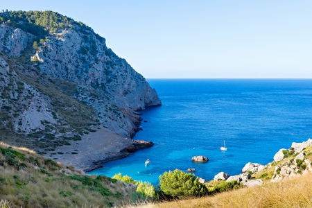 Secret beach - wild coast of Mallorca, Spain, Balearic Islands. Artistic sunrise and dusk landascape. Stock Photo