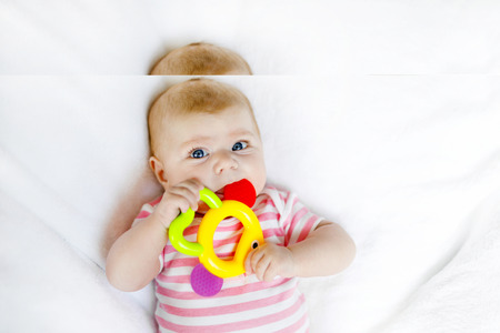 Cute adorable two months baby sucking fist.