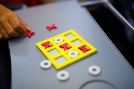 Tic tac toe game. Leisure activity for kids and adults. At home, traveling, on plane.