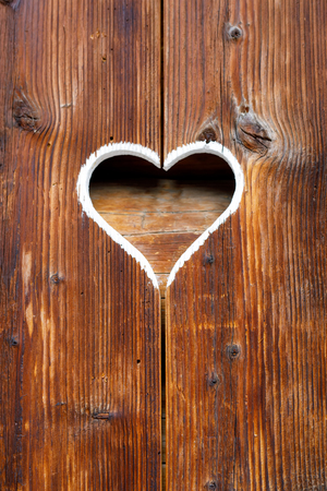 Wooden fence with heart. Part of a window in Tirol, Austria Reklamní fotografie