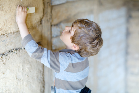 Little kid boy helping with toy tools on construciton site. Stock Photo - 100862945