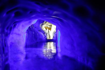 Cross inside the Natural Ice Palace (Ice Cave) at the top of Hintertux Glacier., Austria.