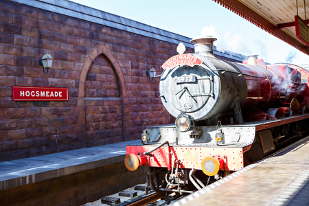 ORLANDO,FL-APRIL 19 2016: Hogsmead and Hogwarts Express train, home to Harry Potter and the Forbidden Journey attraction Orlando USA.