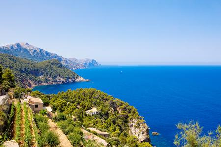 Island scenery, seascape of Mallorca Spain. Idyllic coastline of Majorca, Mediterranean Sea on sunny day. Turquoise water and green hills of Serra de Tramuntana Stock Photo