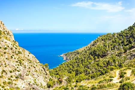 Island scenery, seascape of Mallorca Spain. Idyllic coastline of Majorca, Mediterranean Sea on sunny day. Turquoise water and green hills of Serra de Tramuntana 写真素材