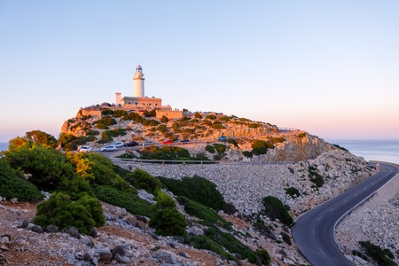 Beautiful white Lighthouse at Cape Formentor in the Coast of North Mallorca, Spain Balearic Islands Artistic sunrise and dusk landascape. Stock Photo - 112739344