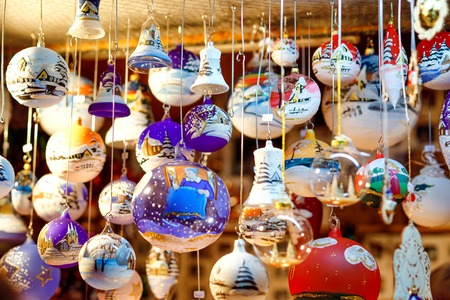 Colorful close up details of christmas fair market. Balls decorations for sales. Xmas market in Germany with traditional decorative toys. Reklamní fotografie