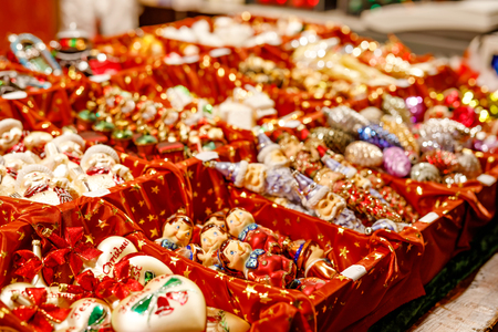 Colorful close up details of christmas fair market. Balls decorations for sales. Xmas market in Germany with traditional decorative toys. Banco de Imagens