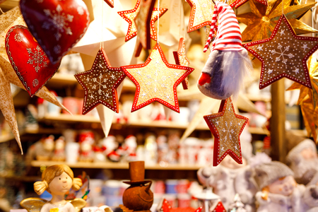Different decoration, toy for xmas tree on christmas market, close up of cozy handmade hearts Reklamní fotografie