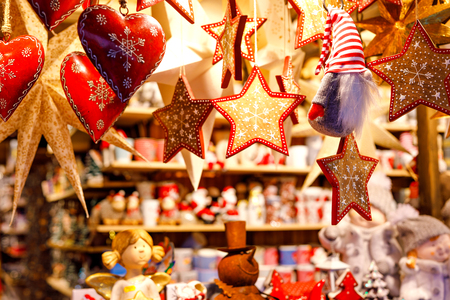 Different decoration, toy for xmas tree on christmas market, close up of cozy handmade hearts Stock fotó