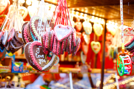 Gingerbread Hearts at German Christmas Market. Nuremberg, Munich, Berlin, Hamburg xmas market in Germany. On traditional ginger bread cookies written I love you called Lebkuchen in German