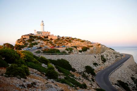 Beautiful white Lighthouse at Cape Formentor in the Coast of North Mallorca, Spain. Balearic Islands . Artistic sunrise and dusk landascape.