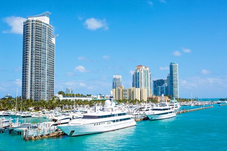 Miami, Florida, USA downtown skyline. Building, ocean beach and blue sky. Beautiful city of United States of America