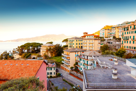 Breathtaking view from window in morning on Liguria region in Italy. Awesome villages of Zoagli, Cinque Terre and Portofino. Beautiful Italian city with colorful houses.