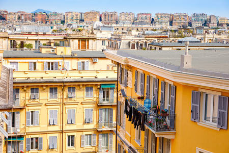 Charming streets of Genoa, Italy. Old famous city of Italy, with beautiful architecture, houses, roofs, buildings on sunny day.