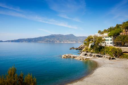 Breathtaking view on Mediterranean sea beach on Liguria region in Italy. Awesome landscape of Zoagli, Cinque Terre and Portofino. Beautiful Italian city with colorful houses. Stock Photo