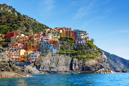 Manarola, Liguria, Italy fisherman village, colorful houses on sunny warm day. Monterosso al Mare, Vernazza, Corniglia, Manarola and Riomaggiore, Cinque Terre National Park