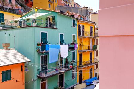 Riomaggiore, Liguria, Italy fisherman village, colorful houses on sunny warm day. Monterosso al Mare, Vernazza, Corniglia, Manarola, and Riomaggiore, Cinque Terre National Park Imagens