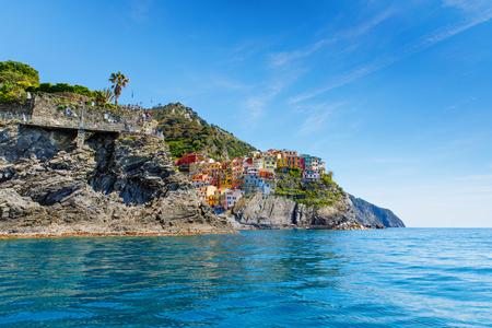 Manarola, Liguria, Italy fisherman village, colorful houses on sunny warm day. Monterosso al Mare, Vernazza, Corniglia, Manarola and Riomaggiore, Cinque Terre National Park