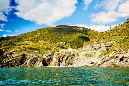 Liguria, Italy coastline of Riviera with colorful houses on sunny warm day. Monterosso al Mare, Vernazza, Corniglia, Manarola and Riomaggiore, Cinque Terre National Park UNESCO World Heritage