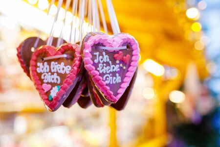 Gingerbread Hearts at German Christmas Market. Nuremberg, Munich, Fulda, Berlin, Hamburg xmas market in Germany. In German language I love you.