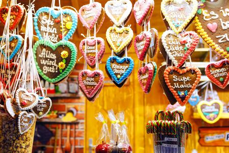 Gingerbread Hearts at German Christmas Market. Nuremberg, Munich, Fulda, Berlin, Hamburg xmas market in Germany. In German language I love you and sweet mouse.