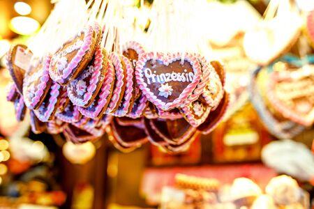 Gingerbread Hearts at German Christmas Market. Nuremberg, Munich, Fulda, Berlin, Hamburg xmas market in Germany. In German language Princess.