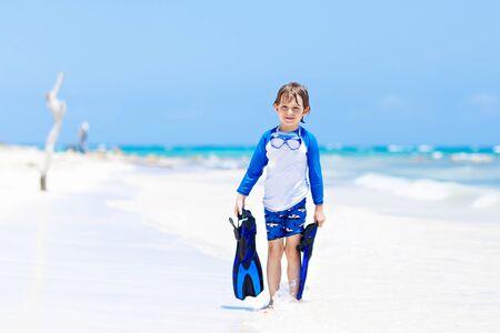 little blond kid boy having fun on tropical beach of Thailand