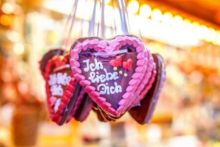 Gingerbread Hearts at German Christmas Market. Nuremberg, Munich, Fulda, Berlin, Hamburg xmas market in Germany. In German language I love you.
