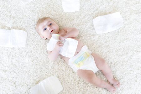 newborn baby girl with diapers. Dry skin and nursery