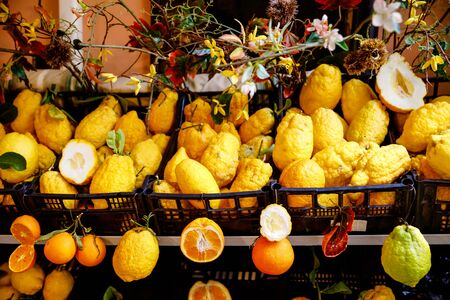 Different variety of lemons for sale. Traditional delicious Italian lemons in Taormina, Sicily, Italy on farmer market Stock Photo
