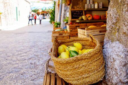 Fresh ripe lemons on a market in old village. Portugal. Imagens