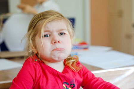 Cute upset unhappy toddler girl crying. Angry emotional child shouting. Portrait of kid with tears. Reklamní fotografie