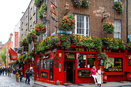 DUBLIN, IRELAND - JULY 1, 2019: Temple Bar is a famous landmark in Dublins cultural quarter visited by thousands of tourists every year. The Temple Bar in the center of the Irish capital.