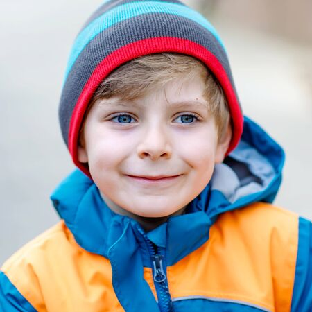 Outdoor fashion portrait of adorable little kid boy wearing colorful clothes. Spring, summer or autumn fashion for boys and children. Schoolkid. Reklamní fotografie