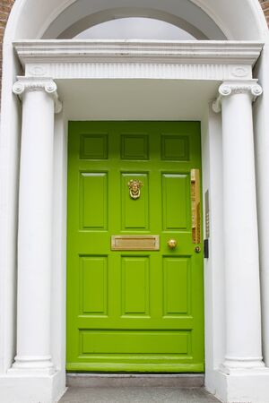 Colorful georgian doors in Dublin, Ireland. Historic doors in different colors painted as protest against English King George legal reign over the city of Dublin in Ireland Banco de Imagens