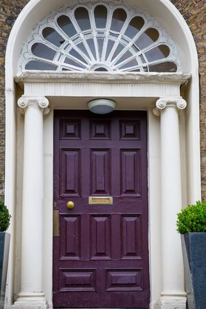 Colorful georgian doors in Dublin, Ireland. Historic doors in different colors painted as protest against English King George legal reign over the city of Dublin in Ireland