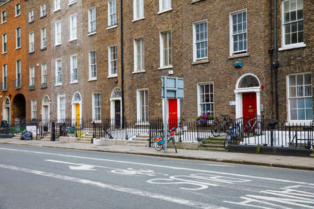 DUBLIN, IRELAND - JULY 2, 2019: Quarter with colorful georgian doors in Dublin, Ireland. Historic doors in different colors painted as protest against English King George legal reign over the city