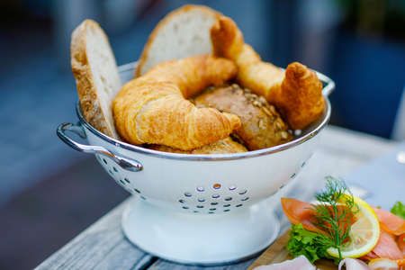 Closeup of different sorts of bread and croissant for breakfast in an outdoor cafe for breakfast