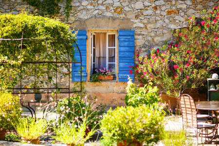 Part of provencal house of small typical town in Provence, France. Beautiful village, with french cute details on summer day. Outdoors, exteriors.