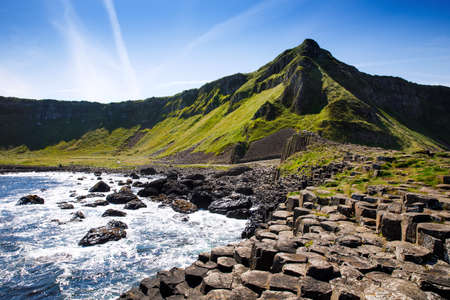 Landscape of Giants Causeway trail with a blue sky in summer in Northern Ireland, County Antrim.