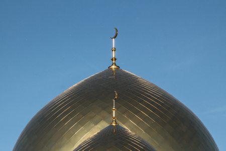The mosque, two golden minarets one after another. The symbol of Islam in the blue sky. Stok Fotoğraf