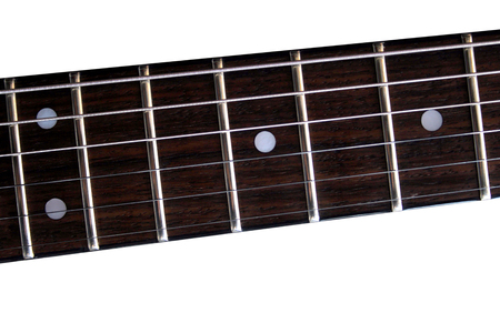 Part of the classic electric guitar fretboard. Isolated on white background. Stock Photo - 81276254