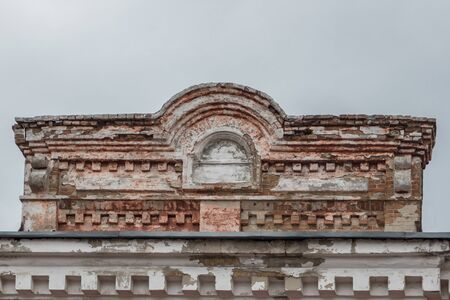 The upper part of the old dilapidated brick building. Stock Photo