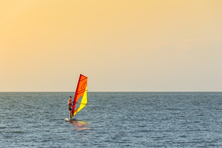 The guy is windsurfing on the Azov Sea. Summer of 2017.