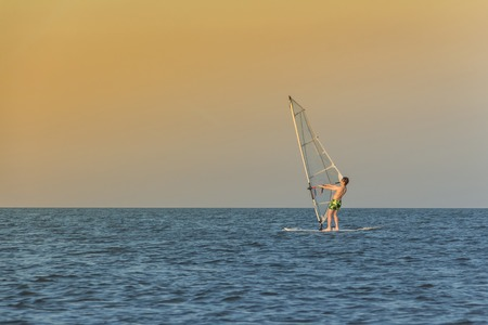 sailboard: The tourist is windsurfing on the Azov Sea.