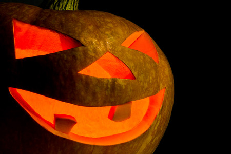 Close-up of pumpkin for Halloween. High quality texture detail on the Jack-o-lantern.