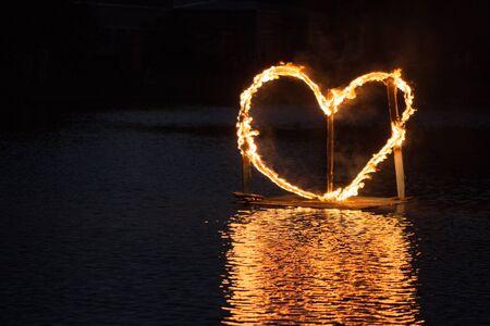 fiery: A fiery heart floats on the water.